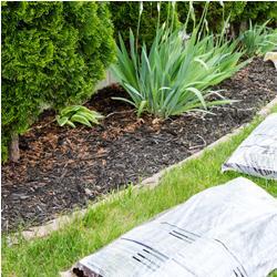 circular image of bags of bark mulch