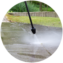 circular image of power washing hose spraying
