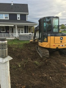 excavating front yard to prepare for new lawn