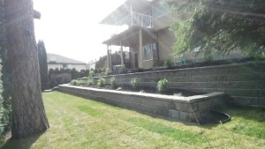 newly installed retaining wall with flower bed