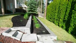 installation of retaining wall, flower bed and stairs