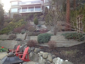 a multi-level retaining wall with shrubs