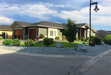 decorative rock in landscaping bed