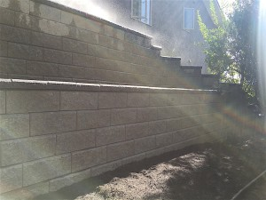 large retaining wall in backyard