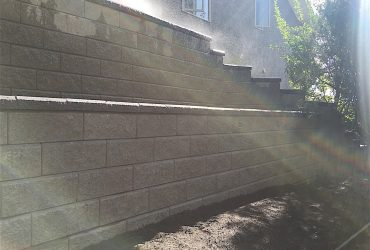 large retaining wall in backyard