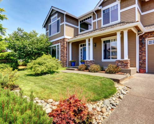 Beautifully landscaped home and walkway.